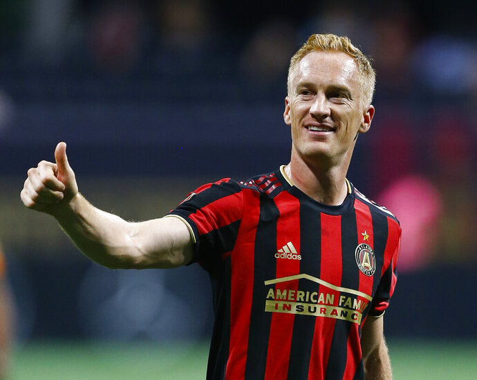 Atlanta United midfielder Jeff Larentowicz gestures to the crowd after the team's MLS soccer match against Toronto FC in Atlanta on Wednesday, May 8, 2019. (AP Photo/Mike Zarrilli)