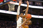Boston College forward Steffon Mitchell, bottom, goes up to shoot against California guard Matt Bradley (20) during the second half of an NCAA college basketball game on Saturday, Dec. 21, 2019, in San Francisco. (AP Photo/D. Ross Cameron)