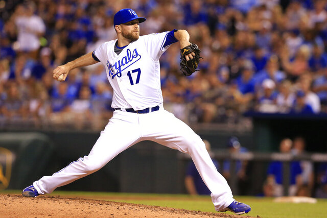 FILE - In this June 13, 2016, file photo, Kansas City Royals relief pitcher Wade Davis throws during a baseball game against the Cleveland Indians at Kauffman Stadium in Kansas City, Mo. Reliever Wade Davis is returning to the Kansas City Royals, the team he helped pitch to the 2015 World Series title. Davis and the Royals agreed Wednesday, Jan. 20, 2021, to a minor league contract, and the 35-year-old right-hander will go to spring training trying to earn a spot on the major league roster. (AP Photo/Orlin Wagner, File)