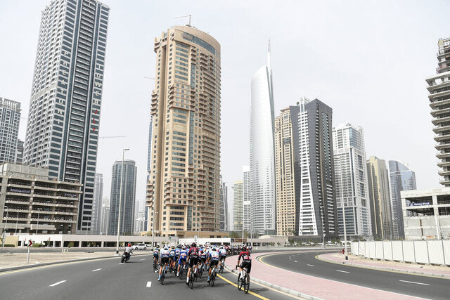 The pack pedals during the fourth stage of the tour of United Arab Emirates cycling race, from Zabeel Park to Dubai City Walk, in United Arab Emirates, Wednesday, Feb. 26, 2020. (Massimo Paolone/LaPresse via AP)