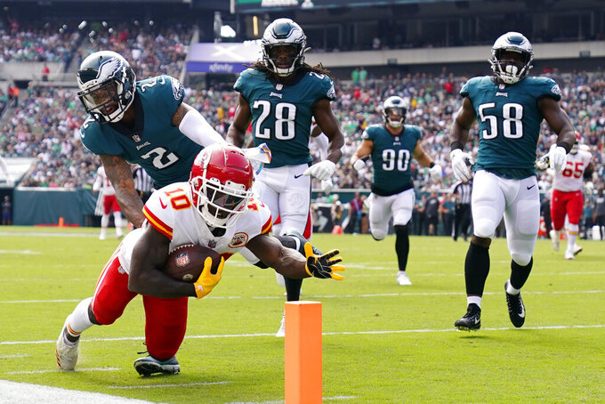 Kansas City Chiefs wide receiver Tyreek Hill (10) dives for extra yards during the first half of an NFL football game against the Philadelphia Eagles on Sunday, Oct. 3, 2021, in Philadelphia. (AP Photo/Matt Rourke)