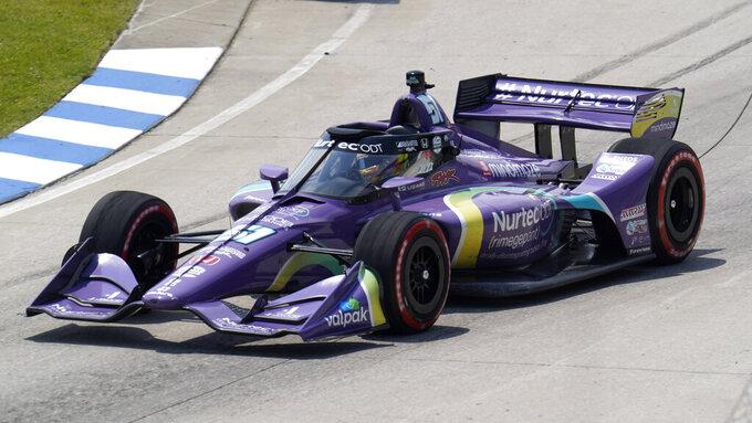 Romain Grosjean races during the first race of the IndyCar Detroit Grand Prix auto racing doubleheader on Belle Isle in Detroit Saturday, June 12, 2021. (AP Photo/Paul Sancya)