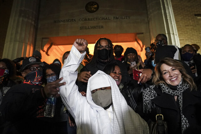 Myon Burrell is released from Minnesota Correctional Facility-Stillwater, Tuesday, Dec. 15, 2020, in Bayport, Minn. Minnesota's pardon board on Tuesday, Dec. 15, 2020, commuted the sentence of Burrell, a Black man who was sent to prison for life as a teen in a high-profile murder case that raised questions about the integrity of the criminal justice system that put him away. (AP Photo/John Minchillo)