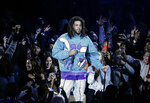 Rapper J. Cole performs at halftime during NBA All-Star basketball game, Sunday, Feb. 17, 2019, in Charlotte, N.C. (AP Photo/Gerry Broome)