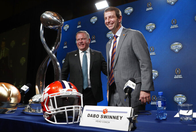 Notre Dame head coach Brian Kelly, left, and Clemson head coach Dabo Swinney smile after concluding the NCAA Cotton Bowl football coaches' news conference in Dallas, Friday, Dec. 28, 2018. Notre Dame is scheduled to play Clemson in the NCAA Cotton Bowl semi-final playoff Saturday. (AP Photo/LM Otero)