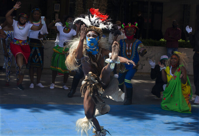 South Africans celebrate Heritage Day with song and dance at the Nelson Mandela Square in Johannesburg, Thursday Sept. 24, 2020. (AP Photo/Denis Farrell)