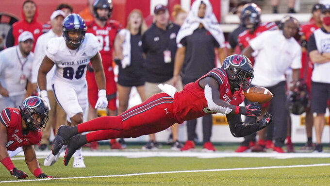Utah linebacker Devin Lloyd makes an interception against Weber State during the first half of an NCAA college football game Thursday, Sept. 2, 2021, in Salt Lake City. (AP Photo/Rick Bowmer)