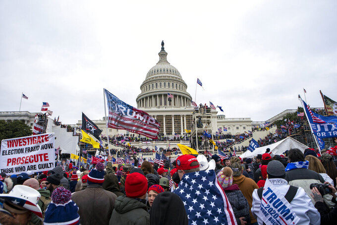 """FILE - In this Jan. 6, 2021, file photo insurrections loyal to President Donald Trump rally at the U.S. Capitol in Washington. The House committee investigating the Jan. 6 insurrection at the Capitol is asking social media and telecommunications companies to preserve phone or computer records for hundreds of people who were potentially involved with planning to """"challenge, delay or interfere"""" with the certification of President Joe Biden's victory. (AP Photo/Jose Luis Magana, File)"""