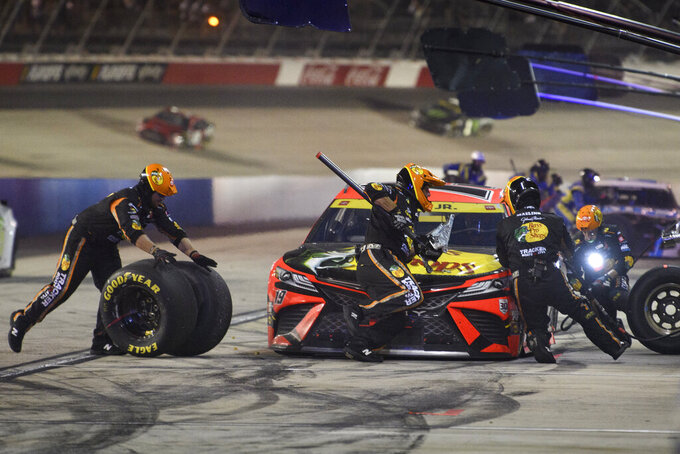 Martin Truex Jr. pits during a NASCAR Cup Series auto race Sunday, Sept. 5, 2021, in Darlington, S.C. (AP Photo/John Amis)