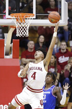Indiana's Trayce Jackson-Davis (4) puts up a shot against Louisiana Tech's Amorie Archibald (3) during the second half of an NCAA college basketball game, Monday, Nov. 25, 2019, in Bloomington, Ind. Indiana won 88-75. (AP Photo/Darron Cummings)