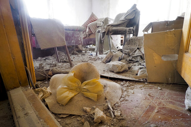 A view of a room of a house damaged by shelling by Azerbaijan's artillery during a military conflict in Stepanakert, the separatist region of Nagorno-Karabakh, Friday, Nov. 6, 2020. Fighting over the separatist territory of Nagorno-Karabakh entered sixth week on Sunday, with Armenian and Azerbaijani forces blaming each other for new attacks. (AP Photo)