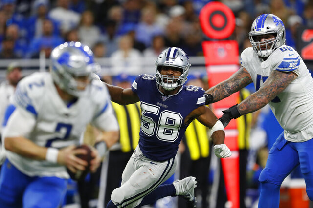 FILE - In this Nov. 17, 2019, file photo, Dallas Cowboys defensive end Robert Quinn (58) chases Detroit Lions quarterback Jeff Driskel (2) during an NFL football game in Detroit. The Chicago Bears finalized a five-year, $70 million contract with former All-Pro pass rusher Quinn on Wednesday, April 1, 2020. (AP Photo/Paul Sancya, File)
