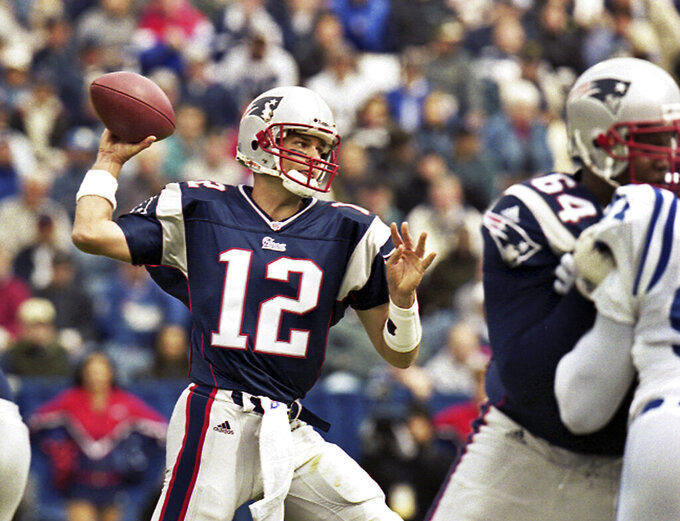 FILE - In this Sept. 30, 2001 file photo, New England Patriots quarterback Tom Brady (12) passes during Brady's first start of an NFL football game against the Indianapolis Colts in Foxborough, Mass. Six quarterbacks were taken ahead of the future first-ballot Hall of Famer Brady in 2000 before the Patriots selected him 199th overall in the sixth round of the NFL draft, forever altering the course of their franchise's history. (AP Photo/Winslow Townson, File)