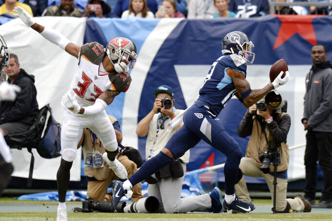 Tennessee Titans wide receiver Tajae Sharpe (19) catches a touchdown pass ahead of Tampa Bay Buccaneers cornerback Carlton Davis (33) in the first half of an NFL football game Sunday, Oct. 27, 2019, in Nashville, Tenn. (AP Photo/Mark Zaleski)