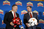 Utah head coach Kyle Whittingham, left, and Texas head coach Tom Herman, right, pose for photos during a news conference for the Alamo Bowl NCAA college football game, Thursday, Dec. 12, 2019, in San Antonio. (AP Photo/Eric Gay)