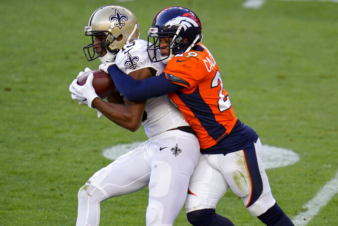 Denver Broncos cornerback Bryce Callahan (29) tackles New Orleans Saints wide receiver Michael Thomas (13) during the first half of an NFL football game, Sunday, Nov. 29, 2020, in Denver. (AP Photo/David Zalubowski)