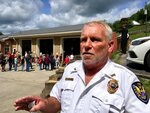 In this May 10, 2019 photo, Kermit, W.Va., volunteer fire chief Tommy Preece speaks outside of his fire station in Kermit, W.Va. Preece lost his brother to a drug overdose in 2017. He said he doesn't need to see federal drug data on prescription painkillers to know his area's history of drug problems.