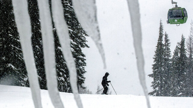 FILE - In this Feb. 25, 2013 file photo, a skier takes advantage of the snowy conditions at Silver Mountain in Kellogg, Idaho. The Shoshone County Sheriff's Office said Tuesday, Jan. 7, 2020, it received reports of up to three separate avalanches on the mountain and that emergency responders were coordinating rescue efforts. (Kathy Plonka/The Spokesman-Review via AP)