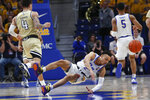 Pittsburgh's Trey McGowens (2) dives for the ball past Georgia Tech's Jordan Usher (4) during the first half of an NCAA college basketball game, Saturday, Feb. 8, 2020, in Pittsburgh. (AP Photo/Keith Srakocic)