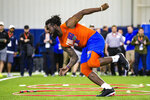 Defensive lineman Jachai Polite runs drills during the University of Florida's football Pro Day in Gainesville, Fla., Wednesday, March 27, 2019.  (Lauren Bacho/The Gainesville Sun via AP)