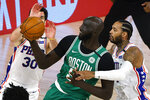 Boston Celtics' Tacko Fall, middle, draws a foul from Philadelphia 76ers' Mike Scott, right, as Furkan Korkmaz (30) defends during the fourth quarter of Game 2 of an NBA basketball first-round playoff series, Wednesday, Aug. 19, 2020, in Lake Buena Vista, Fla. (Kevin C. Cox/Pool Photo via AP)