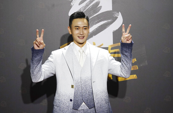 Taiwanese actor Liu Kuan-ting arrives at the 57th Golden Horse Awards in Taipei, Taiwan, Saturday, Nov. 21, 2020. Liu is nominated for Best Leadting Actor for the film