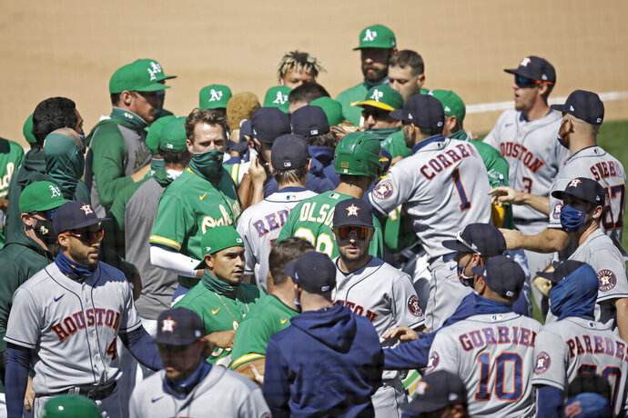 Oakland Athletics and Texas Rangers scuffle after Athletics' Ramon Laureano charged the dugout after being hit by a pitch thrown by Astros' Humberto Castellanos during the seventh inning of a baseball game Sunday, Aug. 9, 2020, in Oakland, Calif. (AP Photo/Ben Margot)