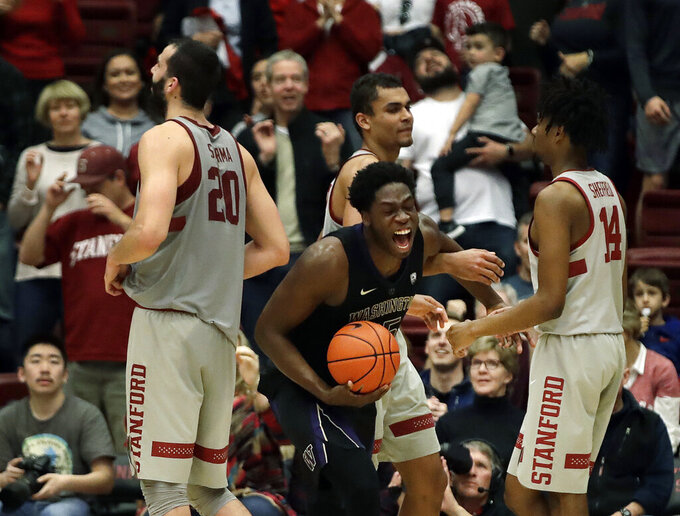 Washington's Noah Dickerson, center with ball, celebrates after the defeat of Stanford at the end of an NCAA college basketball game Sunday, March 3, 2019, in Stanford, Calif. (AP Photo/Ben Margot)
