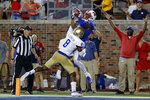 SMU wide receiver James Proche, top,, catches a touchdown pass while Tulsa safety Brandon Johnson (8) defends during the third overtime of an NCAA college football game Saturday, Oct. 5, 2019, in Dallas. SMU won 43-37. (AP Photo/Roger Steinman)