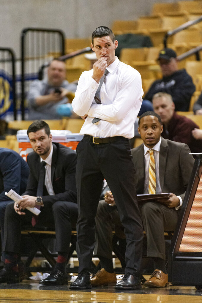 Southern Illinois head coach Bryan Mullins watches his team play during the first half of an NCAA college basketball game against Missouri, Sunday, Dec. 15, 2019, in Columbia, Mo. (AP Photo/L.G. Patterson)