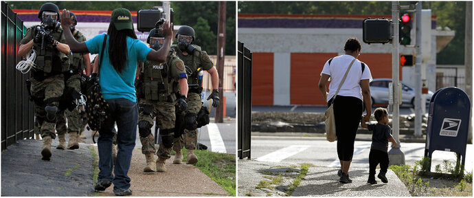 This combination of photos shows police wearing riot gear walking toward a man with his hands raised on Aug. 11, 2014, left, and the same location with a woman and child walking on Canfield Drive toward West Florissant Avenue on July 24, 2019, in Ferguson, Mo. (AP Photo/Jeff Roberson)