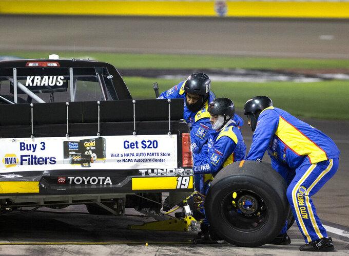 Derek Kraus makes a pit stop during the NASCAR Truck Series auto race at Las Vegas Motor Speedway on Friday, Sept. 25, 2020, in Las Vegas. (Ellen Schmidt/Las Vegas Review-Journal via AP)