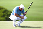 Bryson DeChambeau lines up his putt on the ninth green during the third round of the Tournament of Champions golf event, Saturday, Jan. 9, 2021, at Kapalua Plantation Course in Kapalua, Hawaii. (Matthew Thayer/The Maui News via AP)