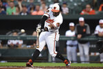 Baltimore Orioles' Dwight Smith Jr. connects for a single against the Boston Red Sox during the first inning of a baseball game Tuesday, May 7, 2019, in Baltimore. (AP Photo/Gail Burton)