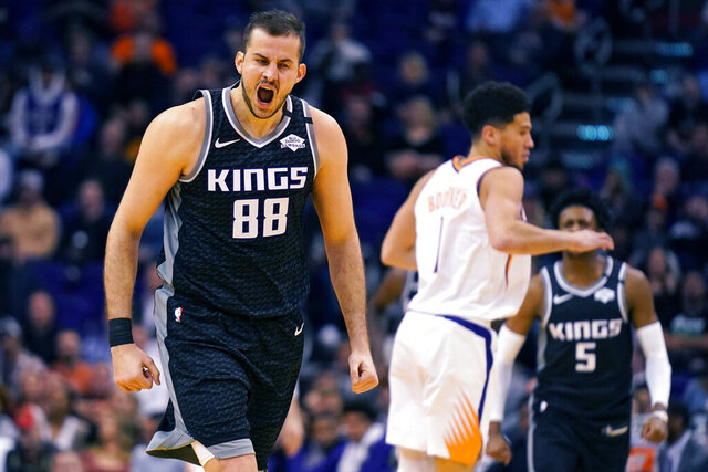 Sacramento Kings forward Nemanja Bjelica (88) reacts after scoring a 3-point basket during the second half of the team's NBA basketball game against the Phoenix Suns, Tuesday, Jan. 7, 2020, in Phoenix. The Kings won 114-103. (AP Photo/Rick Scuteri)