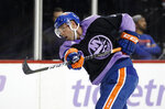 New York Islanders defenseman Johnny Boychuk (55) wears a Hockey Fights Cancer jersey as he warms up before an NHL hockey game against the Florida Panthers, Saturday, Nov. 9, 2019, in New York (AP Photo/Jim McIsaac)