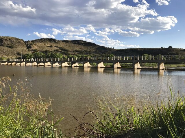 FILE - In this June 22, 2018, file photo, the Rio Grande is diverted near San Acacia, N.M. New Mexico lawmakers are considering setting aside $20 million that could be used as seed money as water managers in the arid state scramble to find ways to reduce groundwater pumping that is at the center of a legal battle over one of North America's longest rivers. The ongoing fight over the Rio Grande has pitted Texas and New Mexico against one another before the U.S. Supreme Court. (AP Photo/Susan Montoya Bryan, File)