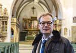 "In this Tuesday, Jan. 14, 2020 photo pastor Johannes Block poses for a photo in the Stadtkirche (Town Church) in Wittenberg, Germany. The church contains a so-called ""Judensau,"" or ""Jew pig,"" sculpture which is located about 4 meters, 13 feet, above the ground on a corner of the Church. A court in eastern Germany will consider next week a Jewish man's bid to force the removal of an ugly remnant of centuries of anti-Semitism from a church where Martin Luther once preached. (AP Photo/Jens Meyer)"