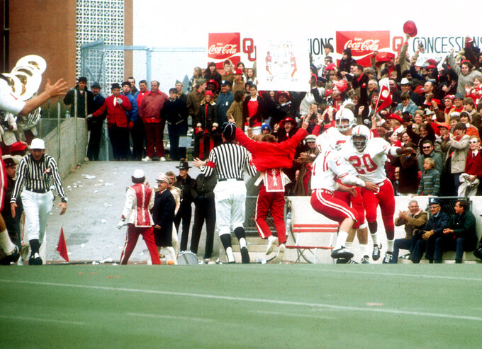 FILE - In this Nov. 25, 1971, file photo, Nebraska's Johnny Rodgers (20) celebrates in the end zone after his long punt return against Oklahoma in Norman, Okla., on Thanksgiving Day. The game on Thanksgiving 50 years ago is back in the spotlight as Nebraska and Oklahoma renew their rivalry on Saturday, Sept. 18, 2021. (Lincoln Journal Star via AP, File)