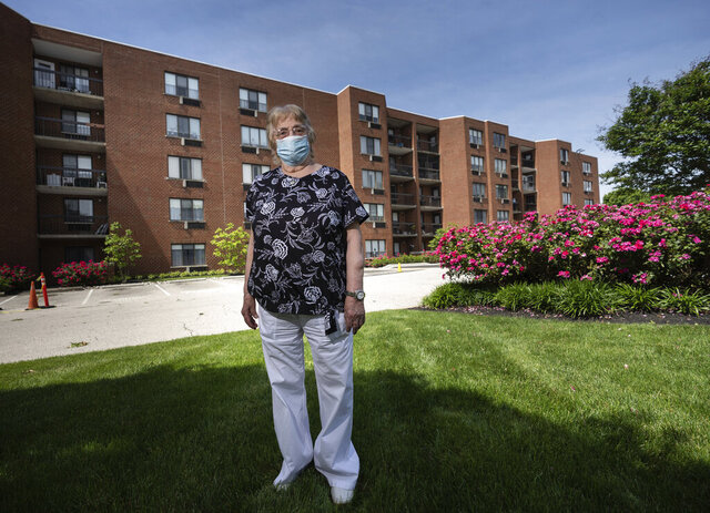 In this June 4, 2020 photo, Anna Marie Bresnan, 85, an independent living resident who survived COVID-19, despite having lung disease, poses in Philadelphia. (Jessica Griffin/The Philadelphia Inquirer via AP)