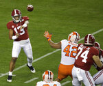 Alabama's Tua Tagovailoa throws during the first half the NCAA college football playoff championship game against Clemson, Monday, Jan. 7, 2019, in Santa Clara, Calif. (AP Photo/Jeff Chiu)