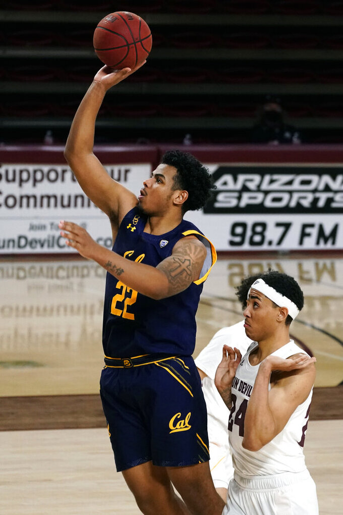 California forward Andre Kelly (22) shoots in front of Arizona State forward Jalen Graham (24) during the second half of an NCAA college basketball game Thursday, Jan. 28, 2021, in Tempe, Ariz. Arizona State won 72-68. (AP Photo/Rick Scuteri)