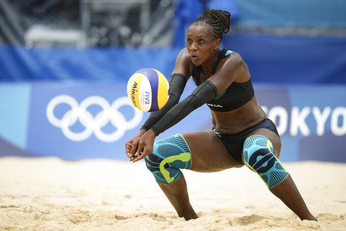Brackcides Khadambi, of Kenya, returns a shot during a women's beach volleyball match against Brazil at the 2020 Summer Olympics, Monday, July 26, 2021, in Tokyo, Japan. (AP Photo/Felipe Dana)