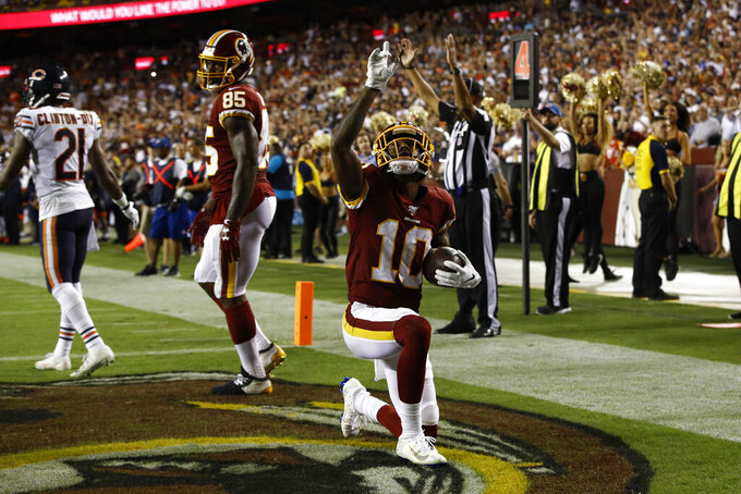 Washington Redskins wide receiver Paul Richardson (10) celebrates his touchdown catch during the second half of an NFL football game against the Chicago Bears, Monday, Sept. 23, 2019, in Landover, Md. (AP Photo/Patrick Semansky)