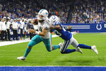 Miami Dolphins quarterback Ryan Fitzpatrick (14) breaks the tackle of Indianapolis Colts cornerback Kenny Moore (23) to score a touchdown during the first half of an NFL football game in Indianapolis, Sunday, Nov. 10, 2019. (AP Photo/AJ Mast)