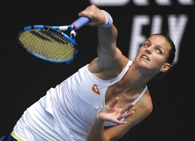 Karolina Pliskova of the Czech Republic serves to compatriot Karolina Muchova during their third round match at the Australian Open tennis championship in Melbourne, Australia, Saturday, Feb. 13, 2021.(AP Photo/Andy Brownbill)