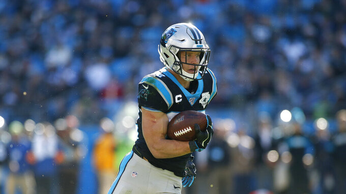 Carolina Panthers running back Christian McCaffrey (22) runs against the Seattle Seahawks during the first half of an NFL football game in Charlotte, N.C., Sunday, Dec. 15, 2019. (AP Photo/Brian Blanco)