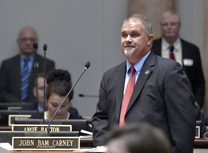 """FILE - In this Jan. 8, 2019 file photo, Kentucky House Majority Leader John Bam Carney R-Campbellsville, addresses the members during the opening day of the legislature in Frankfort, Ky.  Carney died Saturday, July 17, 2021 after battling an illness since late 2019. He was 51. According to a family statement posted by Mark Carney on Facebook, that John Carney """"passed peacefully"""" at the University of Kentucky medical center.   (AP Photo/Timothy D. Easley, File)"""
