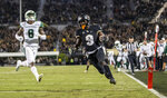 Central Florida running back Adrian Killins Jr. (9) races into the end zone for a touchdown in front of South Florida defensive back Devin Studstill (8) during the first half of an NCAA college football game Friday, Nov. 29, 2019, in Orlando, Fla. (AP Photo/Willie J. Allen Jr.)