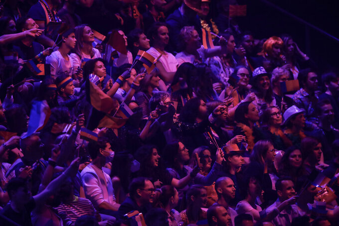 Spectators attend the semi-final of the Eurovision Song Contest at Ahoy arena in Rotterdam, Netherlands, Tuesday, May 18, 2021. The Eurovision Song Contest has been given permission to let 3,500 fans watch in person as part of a trial by the Dutch government. (AP Photo/Peter Dejong)